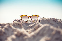 Glasses on a beach Stock Image