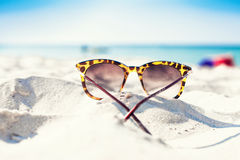 Glasses on a beach Stock Images