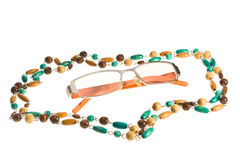 Glasses and Beads Royalty Free Stock Photography