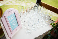 Glasses on a beautiful tray for guests at wedding. Stylish luxury amazing champagne and pouring glasses on a tray, for the celebration of a wedding, catering Royalty Free Stock Photo