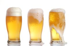Glasses of beer. Three glasses of beer with froth Stock Images