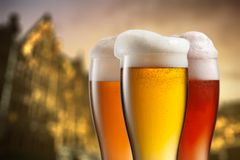Glasses of beer against blurred european city Royalty Free Stock Photography
