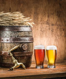 Glasses of  beer and ale barrel on the wooden table. Craft brewe Stock Images