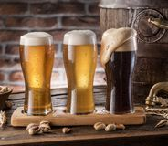 Glasses of beer and ale barrel on the wooden table. Craft brewer. Y stock photo