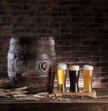 Glasses of beer and ale barrel on the wooden table. Craft brewer. Y stock image