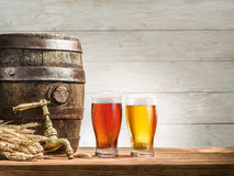 Glasses of beer and ale barrel on the wooden table. Craft brewery royalty free stock photos