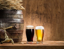 Glasses of  beer and ale barrel. Stock Photos