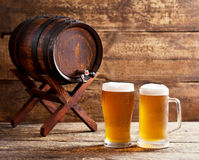 Glasses of beer with barrel Stock Image