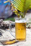 Glasses of beer on beach Stock Images