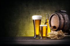 Glasses of beer with bottle and barrel Stock Image