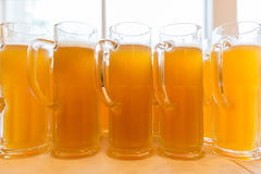 Glasses of beer. Many glasses of beer in a pary Stock Image