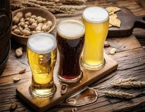 Glasses of beer and snacks on the wooden table. Top view stock images