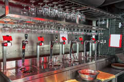 Glasses and beer taps Royalty Free Stock Photos