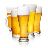 Glasses of beer on white Royalty Free Stock Photography