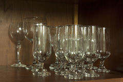 Glasses of beer and wine. In the cabinet Royalty Free Stock Photography