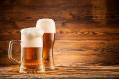 Glasses of beer on wooden planks Stock Photo