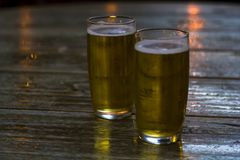 Glasses of beer on wooden table royalty free stock photos