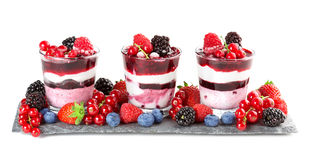 Glasses of berries parfait. Glasses with layered dessert and soft fruit on slate Royalty Free Stock Photo