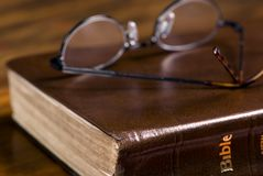 Glasses on Bible 3 Stock Image