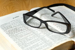 Glasses on a Bible Royalty Free Stock Photo