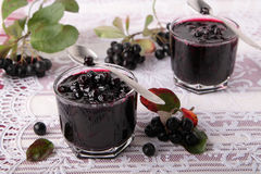 Glasses with black chokeberry jam Royalty Free Stock Photos