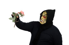 Glasses black monster looks at pink rose. Glasses black masked monster looks at pink rose on white background Stock Images