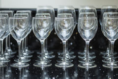 Glasses on a black plane. Wine glasses on black marble Royalty Free Stock Photo