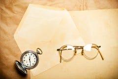 Glasses on blank envelope Stock Photos