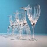 Glasses in blue. A row of glasses lighted out in blue Royalty Free Stock Images