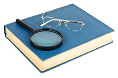 Glasses on a blue book Stock Photography