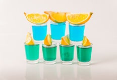 Glasses with blue and green kamikaze, glamorous drinks, mixed dr Royalty Free Stock Image
