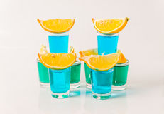 Glasses with blue and green kamikaze, glamorous drinks, mixed dr Royalty Free Stock Photography