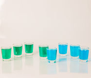 Glasses with blue and green kamikaze, glamorous drinks, mixed dr Royalty Free Stock Images