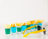 Glasses with blue and green kamikaze, glamorous drinks, mixed dr Stock Images