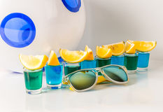 Glasses with blue and green kamikaze, glamorous drinks, mixed dr Royalty Free Stock Photos