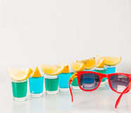 Glasses with blue and green kamikaze, glamorous drinks, mixed dr Stock Photo