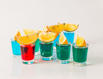 Glasses with blue, green and red kamikaze, glamorous drinks, mix Royalty Free Stock Photos