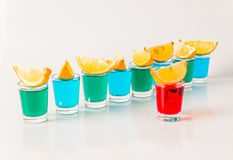 Glasses with blue, green and red kamikaze, glamorous drinks, mix Royalty Free Stock Image