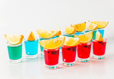 Glasses with blue, green and red kamikaze, glamorous drinks, mix Stock Image
