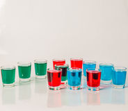 Glasses with blue, green and red kamikaze, glamorous drinks, mix Stock Images