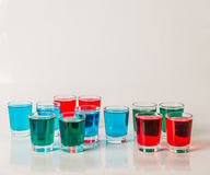 Glasses with blue, green and red kamikaze, glamorous drinks, mix Stock Photography