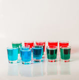 Glasses with blue, green and red kamikaze, glamorous drinks, mix Royalty Free Stock Photo