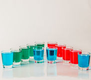 Glasses with blue, green and red kamikaze, glamorous drinks, mix Stock Photo