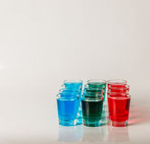 Glasses with blue, green and red kamikaze, glamorous drinks, mix Stock Photos