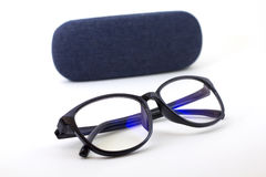 Glasses with blue jeans. Black retro glasses with blue jeans texture case on white background Royalty Free Stock Photos