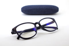 Glasses with blue jeans. Black retro glasses with blue jeans texture case on white background Royalty Free Stock Photo