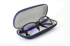 Glasses with blue jeans. Black retro glasses with blue jeans texture case on white background Royalty Free Stock Images