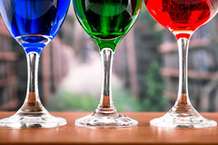 Glasses with blue red and green liquid cocktails Royalty Free Stock Photography