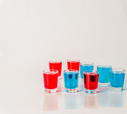 Glasses with blue and red kamikaze, glamorous drinks, mixed drink poured into shot glasses. Party set royalty free stock photo