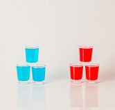 Glasses with blue and red kamikaze, glamorous drinks, mixed drink poured into shot glasses. Party set stock photos